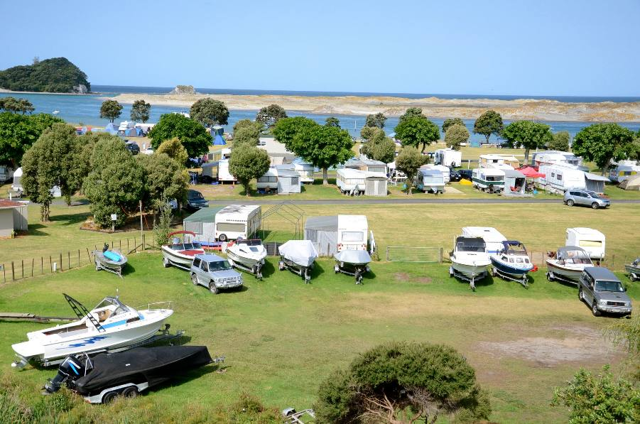 From back of park with boat parking area, annual sites and powered and tent sites towards beach on south side
